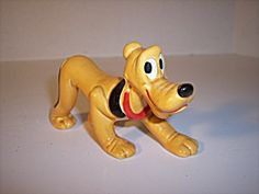Pluto is long. He stands 2 tall.Disney porcelain figurine of Pluto.