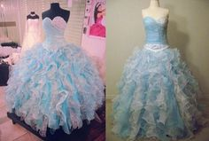 How unique this LaGlitter® replica ball gown with its beaded bodice,  sparkly tulle and blue and white ruffles galore.