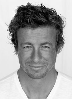 My husband could totally pull off the Simon Baker-Wild-Wavy Locks look...and I think he should. :)