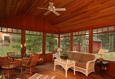 Lovely three season porch with vaulted wood ceiling.