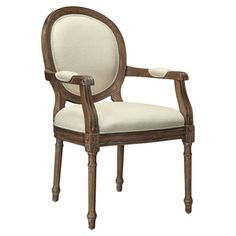 Bring polished elegance to your dining room or eat-in kitchen with this lovely hand-carved arm chair, showcasing fluted legs and beige upholstery.  ...