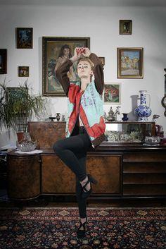 "a jacket, a painting by Grażyna Brylewska entitled ""Roses for Cy Twombly""; photo: Dawid Kot, model: Anna Maria Marylska;"
