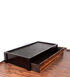 This classy two toned single bed is a must have for bachelors and teenagers. Its two toned structure will blend beautifully with any dcor. It has a sturdy structure which ensures you that it will offer you a great sleeping experience after a long and tiring day. It also comes with a rectangular storage box wherein you can store your blankets and mattresses. A classy and simple appearing piece of furniture that is also a space saver. Check from range of single bed designs online on…