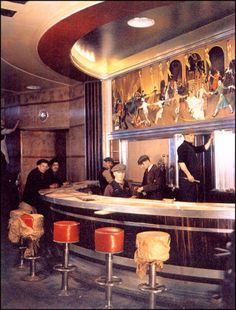 RMS Queen Mary, early 1930s Interior painting work on the round bar. Madame Yevonde