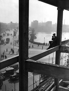 A workman rests on a girder during the construction of Unilever House in Blackfriars, London, 17th March 1931.  From Fox Photos/Getty Images