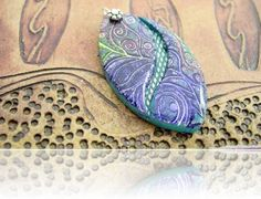 Pendant #3, which is a purple blue based on my Batik Tutorial. The River Channel is inspired by the lovely Julie Picarello by Tina Holden