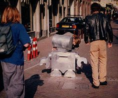 """Pamphleteer, aka """"Little Brother,"""" is a propaganda robot which distributes subersive literature in public space.    (by the Institute for Applied Autonomy)"""