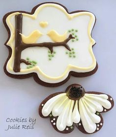 Cookies by Julie Reis:  Coneflower and love birds sitting in a tree.  Cutters from Whisked Away Cutters.