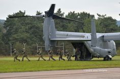 Special operations forces storm off a U.S. Air Force CV-22 Osprey during a demonstration at Jackal Stone 14, an exercise hosted by the U.S. Special Operations Command Europe at Baumholder, Germany, Friday, Sept. 12, 2014. Forces from 10 nations are taking part in the event in numerous locations in Germany and the Netherlands. (Michael Abrams/Stars and Stripes)