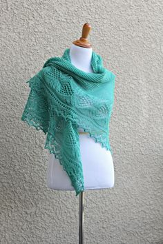 This hand knit #shawl is made of 100% wool in lovely mint green color. The shawl…