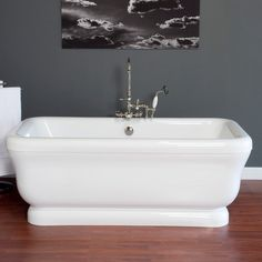 This 70 inch Acrylic Double Ended Pedestal tub by Strom Plumbing adds a contemporary style to any space.