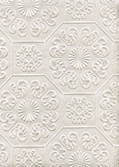 WALL TREATMENT Textured neutral wallpaper in Rococo style with dominant decorative patterns combined with geometric shapes.