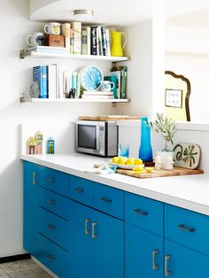 Add shelves to an unused corner of the kitchen for cookbooks, colorful dishware, or other kitchen accents. In a small kitchen, every inch of wall space counts.