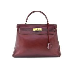 Authentic Hermes Burgundy Box Leather Kelly 32 Bag at THEBROWNPAPERBAG. Every item is guaranteed authentic and sold with a 14 day return policy. Hermes Box, Hermes Kelly, Burgundy, Leather, Bags, Fashion, Handbags, Moda, Fashion Styles