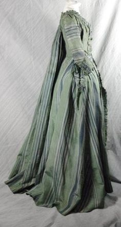 """""""Robe Watteau"""" 1770 Taffeta de Soie striped green tone blue and white pleated Watteau back This toilet is composed of its cloak dress decorated on the front and sleeves and pleated frills also pierced the front of the skirt. Linen lining to closure strips of linen, the linen lining is dusty. The skirt is damaged on the top level of drawstrings and front and back on top The coat dress has some small spots and weaknesses in some areas"""