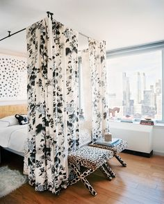 Michelle Adams Photo - A floral bed canopy and a pair of leopard-print benches