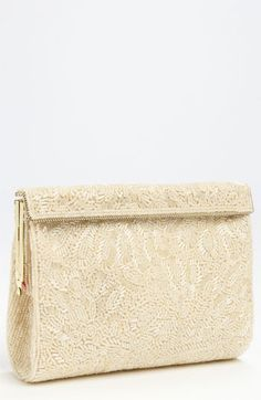 Free shipping and returns on Nina Beaded Frame Clutch at Nordstrom.com. Lavish beading ornaments a refined clutch outfitted with a slinky serpentine chain for versatility.