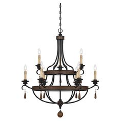 Showcasing a bronze finish and rustic-inspired design, this 9-light chandelier casts a warm glow over your entryway or dining room.