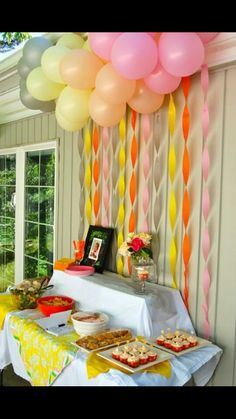 Table set up for gift & guest area. Balloons, paper decor, and table cloth.