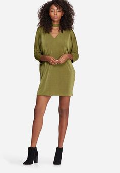 When shopping for dresses, the tendency is to neglect possible cold-weather options like this one. It has an oversized pullover design, constructed from a glossy stretch fabric and featuring a v-neck with choker detail, as well as half-length sleeves. Add a black bomber jacket and add your go-to ankle boots. Pullover Designs, Neck Choker, Khaki Dress, Black Bomber Jacket, Stretch Fabric, Cold Weather, Ankle Boots, Chokers, Shirt Dress