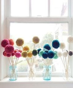 Love this colourful display of pom-pom flowers displayed on a sunny windowsill.