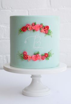 fondant cake with piped flowers by erica obrien cake design