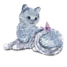 Handcrafted of heirloom-quality genuine crystal. Swirls and waves recreate each cat's expressive face, graceful pose, gleaming fur and fluffy tail.