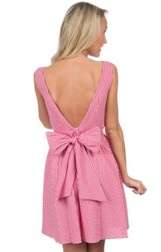 Your favorite Lauren James dress just got even better! We guarantee that you'll be turning heads wherever you go in this perfect gingham dress. This little number has a high scoop neck with princess s
