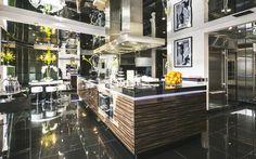 Dark kitchen in Tom Cruise's London Penthouse // Interior Designer Paul Davies