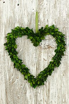 17.99 SALE PRICE! Add a touch of vibrant greenery to your home or event with this Heart shaped Boxwood Wreath! The wreath is made of preserved boxwood and wi...