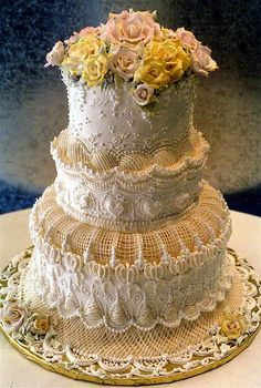 what a creative wedding cake design!  it is amazing.  it almost looks like some type lace or cheese cloth..............it is really gorgeous.
