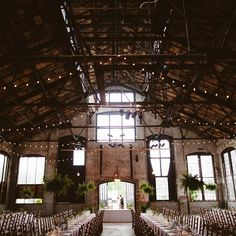 WEDDING IN A RESTORED FACTORY | BASILICA HUDSON NY. The structure of this old beauty has been restored but its unpolished and historic bones give it the kind of charm money cant buy.  Steel trusses & terra-cotta ceilings gussied up with macrame vintage rugs and blooms  from @solflowerfarm gave it just the right amount of warmth. And those market lights & floor-to-ceiling windows? Perfect for that golden hour light  and dancing into the dark.  TAP LINK IN PROFILE  for the full wedding story…
