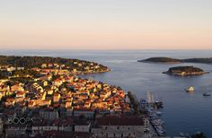 Adriatic Sunset by Angshu from http://500px.com/photo/217395889 - Hvar is a Croatian island in the Adriatic Sea located off the Dalmatian coast. The charm of Hvar lies in the mix of architectural Gothic Renaissance and the role that the Venetian aristocracy has given this place styles.  I took this shot from the top of Fortica from where the view over the harbour is magnificent. The sun had begun its descent towards the horizon bathing the picturesque town in golden light.. More on…