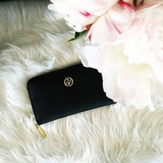 Tory Burch Zip Robinson Continental Wallet NWOT Like new Tory Burch leather wallet in black. No signs of wear. The epitome of understated chic, This wallet is made of the highest-quality, scratch-resistant leather. Designed with lots of pockets — and a long shape that fits all full-length bills without folding — it keeps essentials incredibly well organized. Product Specs: Scrub genuine leather 2 Interior currency compartments 1 Center zipper compartment 8 Interior card slots 3 Piece logo…