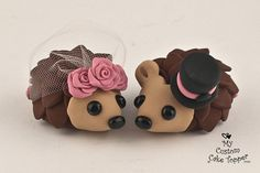 Hedgehogs Wedding Cake Topper with Roses on Etsy, $72.56  I'd want green on the boy's hat and purple daisies on the girl :)