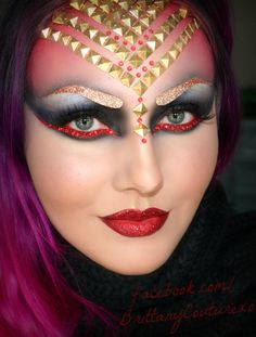 Colorful gold and red jewel accented fantasy make-up.