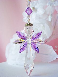 Swarovski Crystal Suncatcher Angel Car Charm created with Violet Purple and Aurora Borealis Crystals. Hang this beautiful angel from the rear view mirror in your car to help bring love and protection to you while youre driving:-)  Inspired by the Angels and Created to Bring Love and Light to You and Your Car with Sparkling Crystal Energy~ Violet Crystals symbolize the energy of Magic, Imagination and Dreams. Clear Crystals symbolize the energy of New Beginnings and Kindness.  Created with…