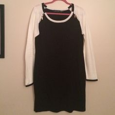 "Black and White Ivanna Trump Sweater Dress A perfect work dress. Worn once. In excellent condition. 100% acrylic. From shoulder to hem measures 37.5"" armpit to armpit 19"" stretchy, comfy and warm! :) Ivanka Trump Dresses Long Sleeve"