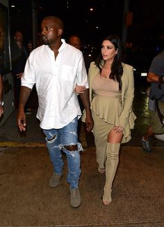 Pin for Later: Kim Kardashian Can't Stop, Won't Stop Lacing Up Her Baby Bump