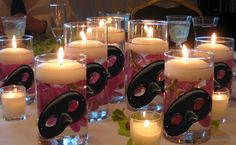 Use red instead of pink flowers, dark red instead of white table cloths, add glowstick and maybe food dye