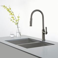 Keep kitchen cleaning under control with the help from this Nola single-lever pull-down kitchen faucet from Kraus. This kitchen faucet provides durability with its stainless-steel construction, making