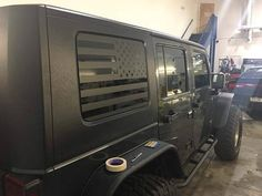 SOLD AS A PAIR - driver side and passenger side. Passenger side is flipped so the stars are towards the front of vehicle. Matte black american flag decal, for rear side windows of JEEP WRANGLER, JEEP WRANGLER LIMITED, JEEP PATRIOT. Select your vehicle below. Decal runs about 3/4