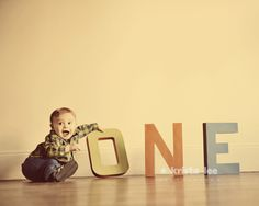 Mom painted letters from the craft store for his one year photos, LOVE this idea!