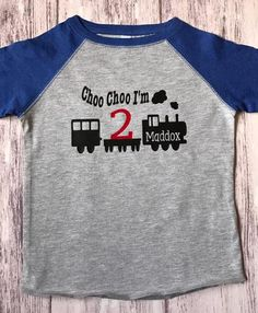 This is a custom train t-shirt for your train fan! This shirt is made to order we can customize the numbers on the train and your child's name! The pictured shirt is Royal blue/grey raglan **Available