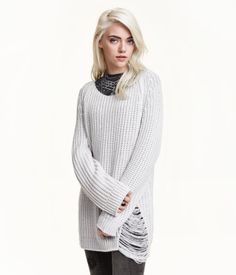 Long-sleeved, rib-knit sweater with heavily distressed details. Slightly wider neckline.