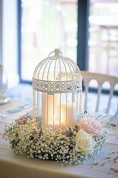 White birdcage with floral arrangement.