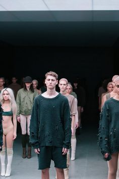 Torn knit sweaters at Kanye West x adidas AW15 NYFW. See more here: http://www.dazeddigital.com/fashion/article/23612/1/kanye-drops-a-new-track-with-sia-listen-here