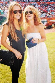 LC and Lo. my faves. and it looks like they're at a Miami Dolphins game! even better!