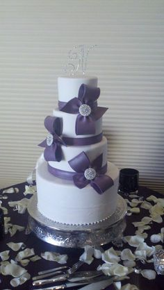 Purple bow cake by Designer Cakes By April, via Flickr