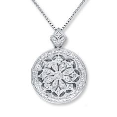 An elaborate design of diamonds and milgrain blooms at the center of this breathtaking locket necklace for her. Styled in gleaming sterling silver, the necklace has a total diamond weight of 1/10 carat. The eye-catching pendant swings from an 18-inch box chain secured with a lobster clasp. Diamond Total Carat Weight may range from .085 - .11 carats.